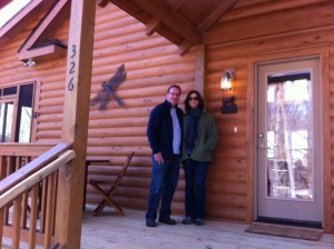 The Locascios family, in front of their new log home, says they recommend Carolina Diversified Builders.
