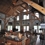Timber frame kitchens and dining rooms in North and South Carolina, by Carolina Diversified Builders.